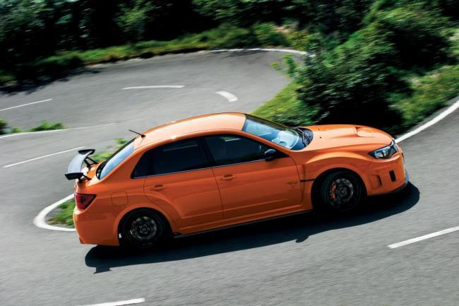 Subaru Impreza STi lateral naranja